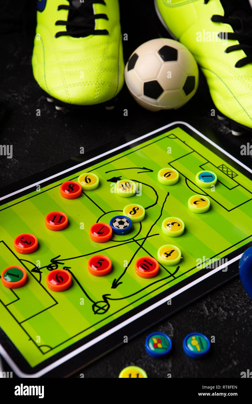 Photo of table football, soccer ball, boots, toys - Stock Image