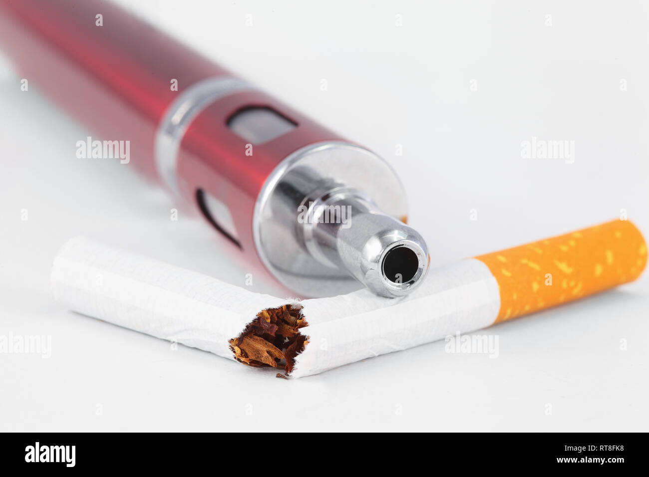 e-zigarette and a broken tobacco cigarette - Stock Image