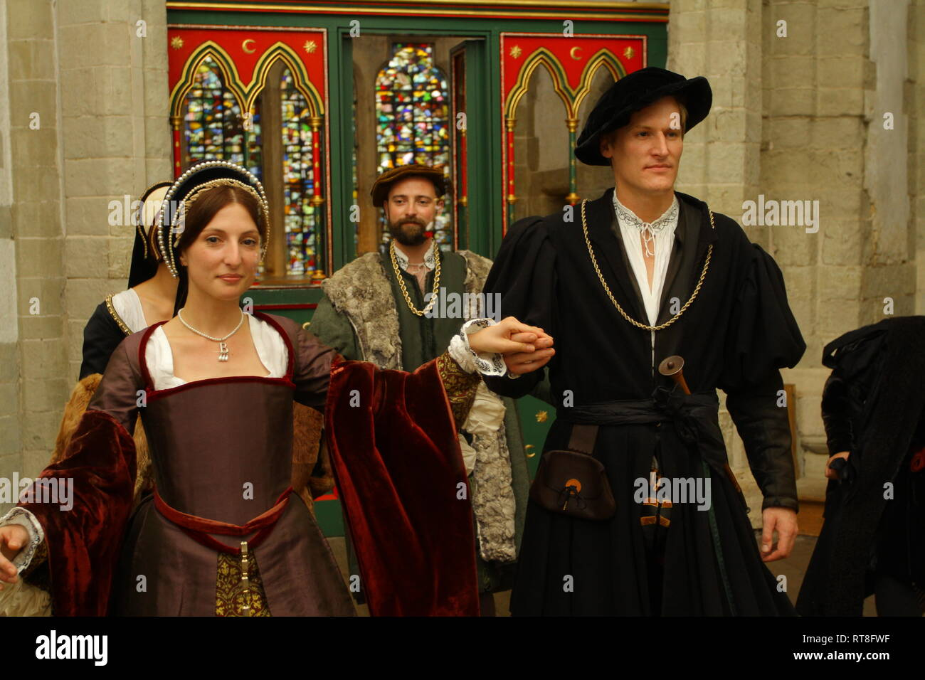 Anne Boleyn and Henry VIII are art a dance with courtiers at The Tower of London - Stock Image