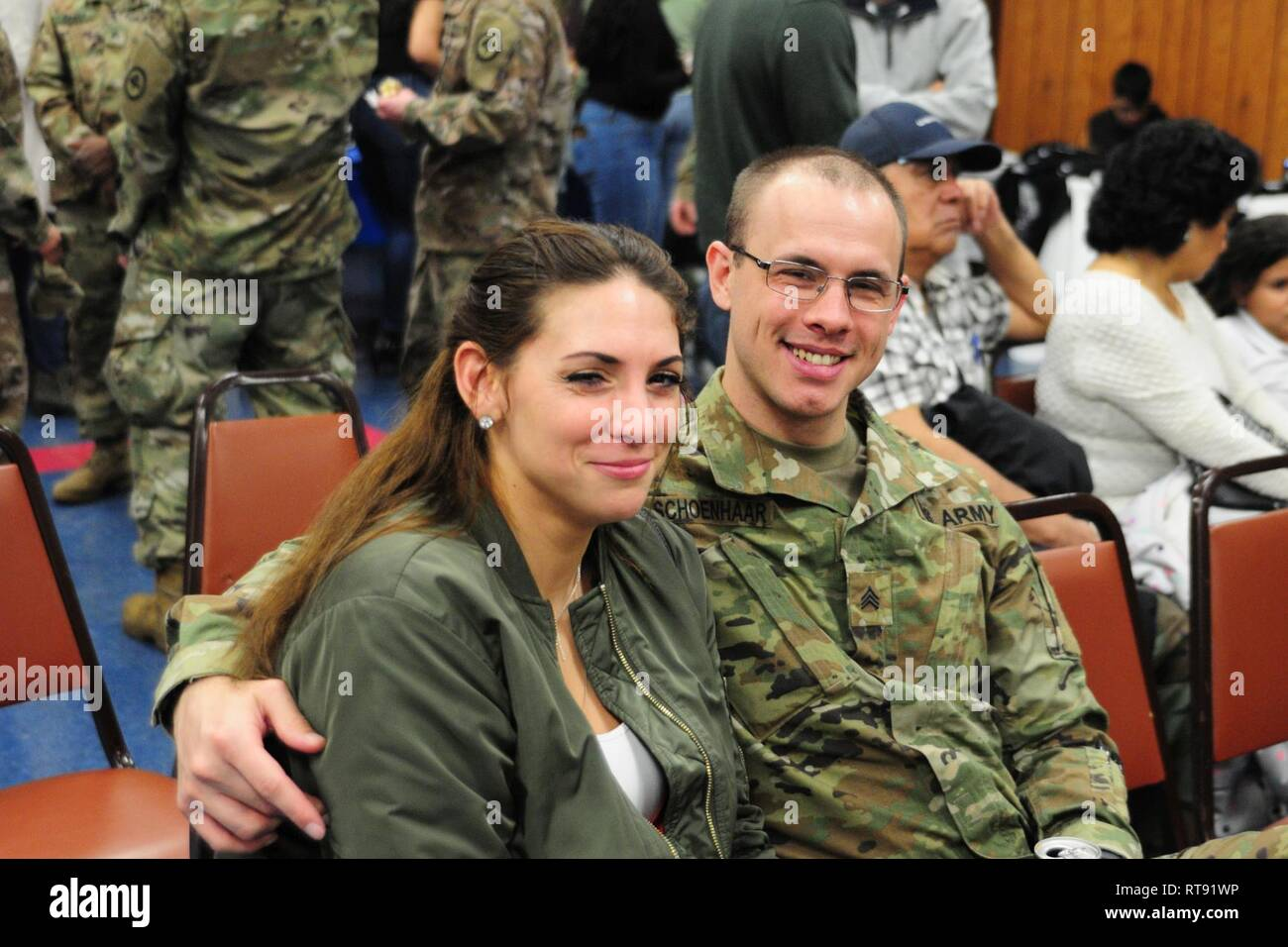 Sgt. Michael J. Schoenhaar poses for a photo with a family member at the 250th Brigade Support Battalion's farewell ceremony. Soldiers from Hotel Company, 250th BSB, said farewell to family, friends and New Jersey National Guard leadership at a farewell ceremony Feb. 5, 2019 at the Veterans of Foreign Wars Post 5084 in Elmwood Park, New Jersey. The Teaneck-based Soldiers will deploy to the Horn of Africa in support of Operation Enduring Freedom. - Stock Image
