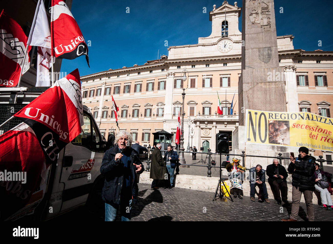 Rome, Italy. 27th Feb, 2019. Stefano D'Errico, National Secretary of Unicobas School and University during the protest, in Montecitorio square against the regionalization, the process of differentiated autonomy. Credit: Andrea Ronchini/Pacific Press/Alamy Live News - Stock Image