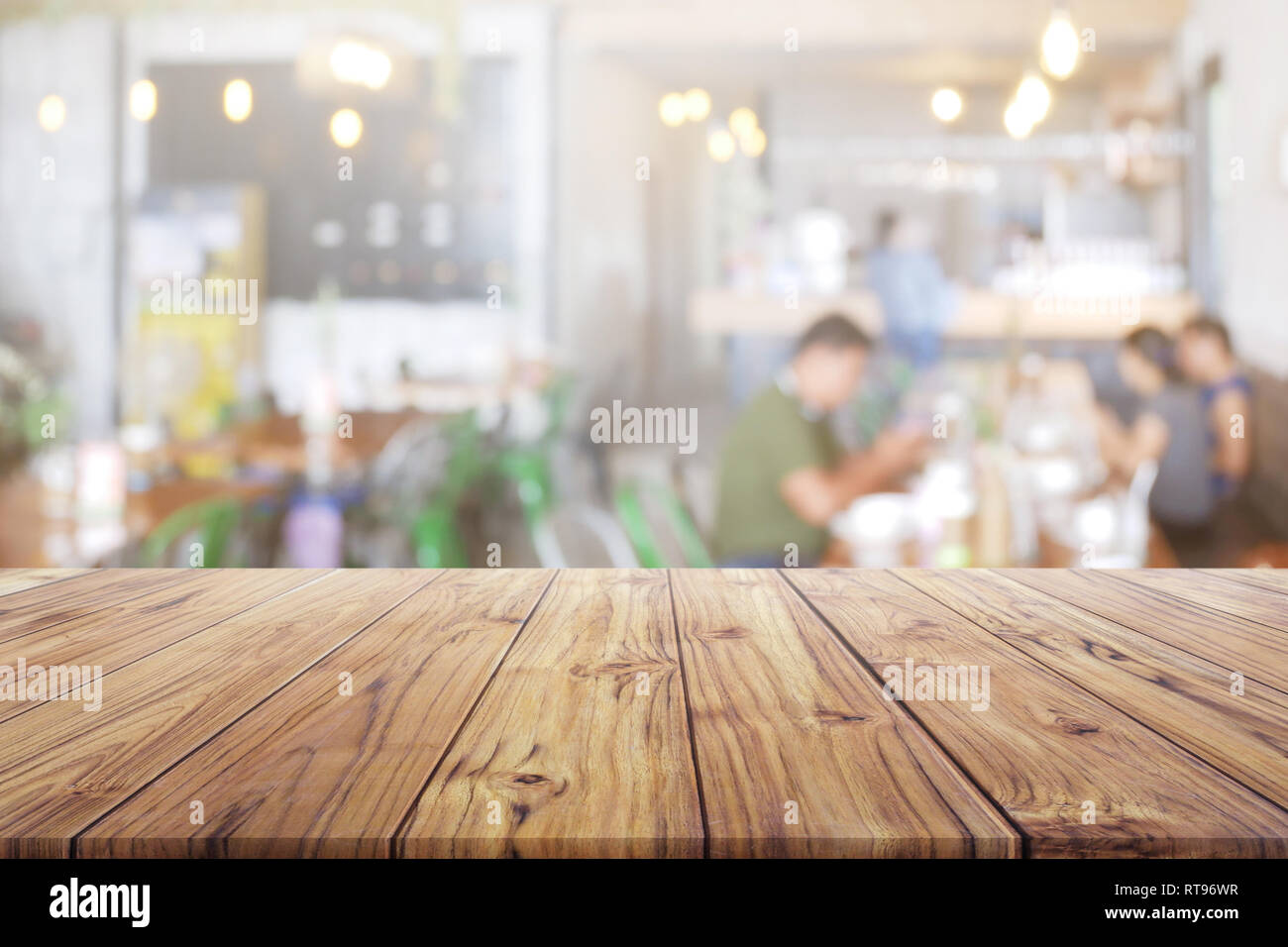 Blank Wood Table Top With People At Restaurant Or Coffee Cafe Background For Montage Product Present Stock Photo Alamy