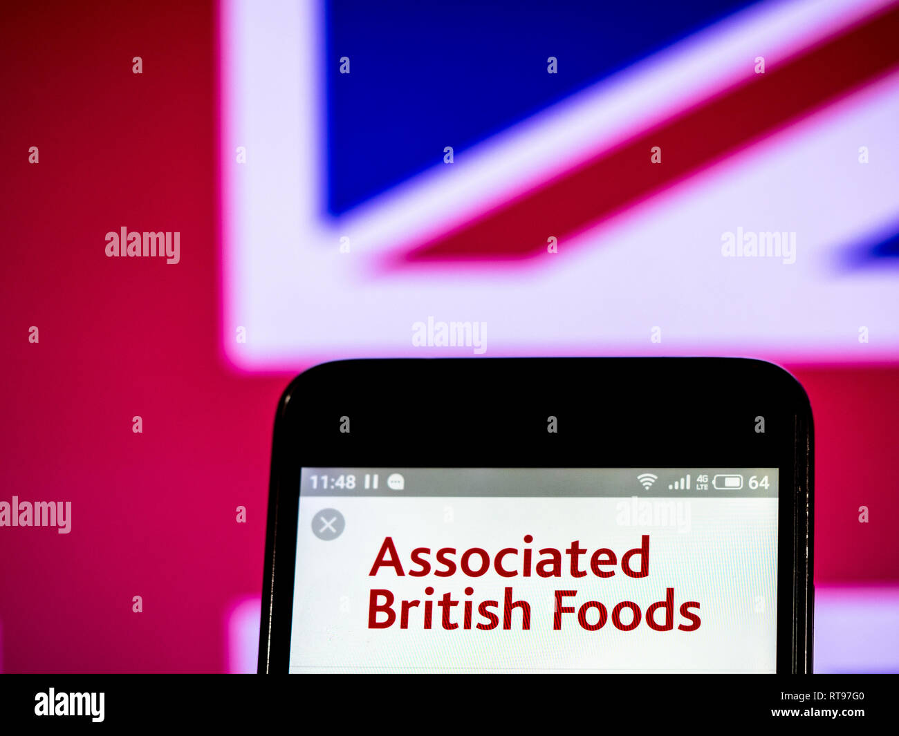 Associated British Foods plc logo seen displayed on smart phone - Stock Image