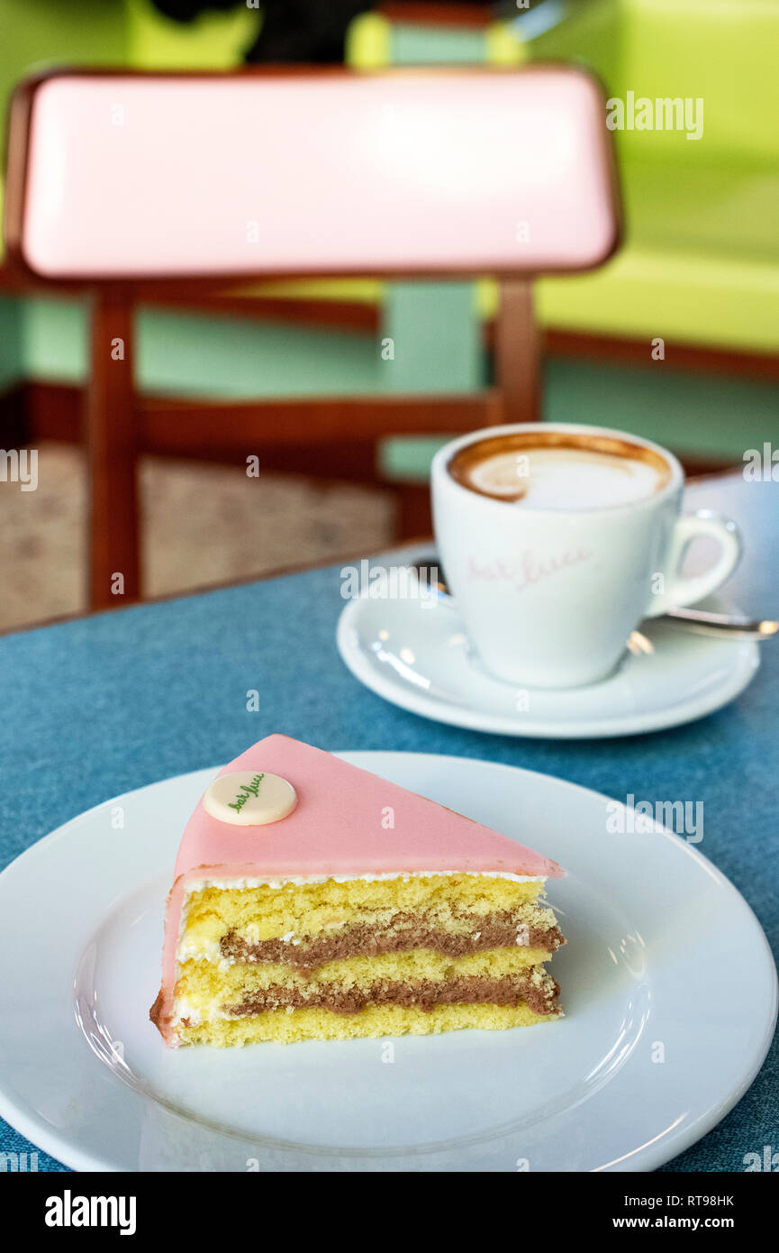 Cappuccino, Torta Rosa and pastel furniture at Bar Luce, Wes Anderson-inspired bar and cafe in the Fondazione Prada district of Milan, Italy - Stock Image