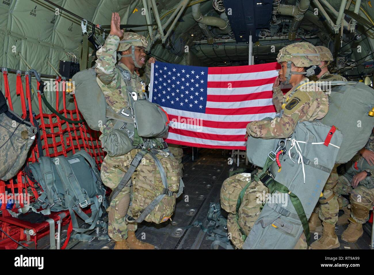During a airborne operation, Staff Sgt  Miata K  Cole (right
