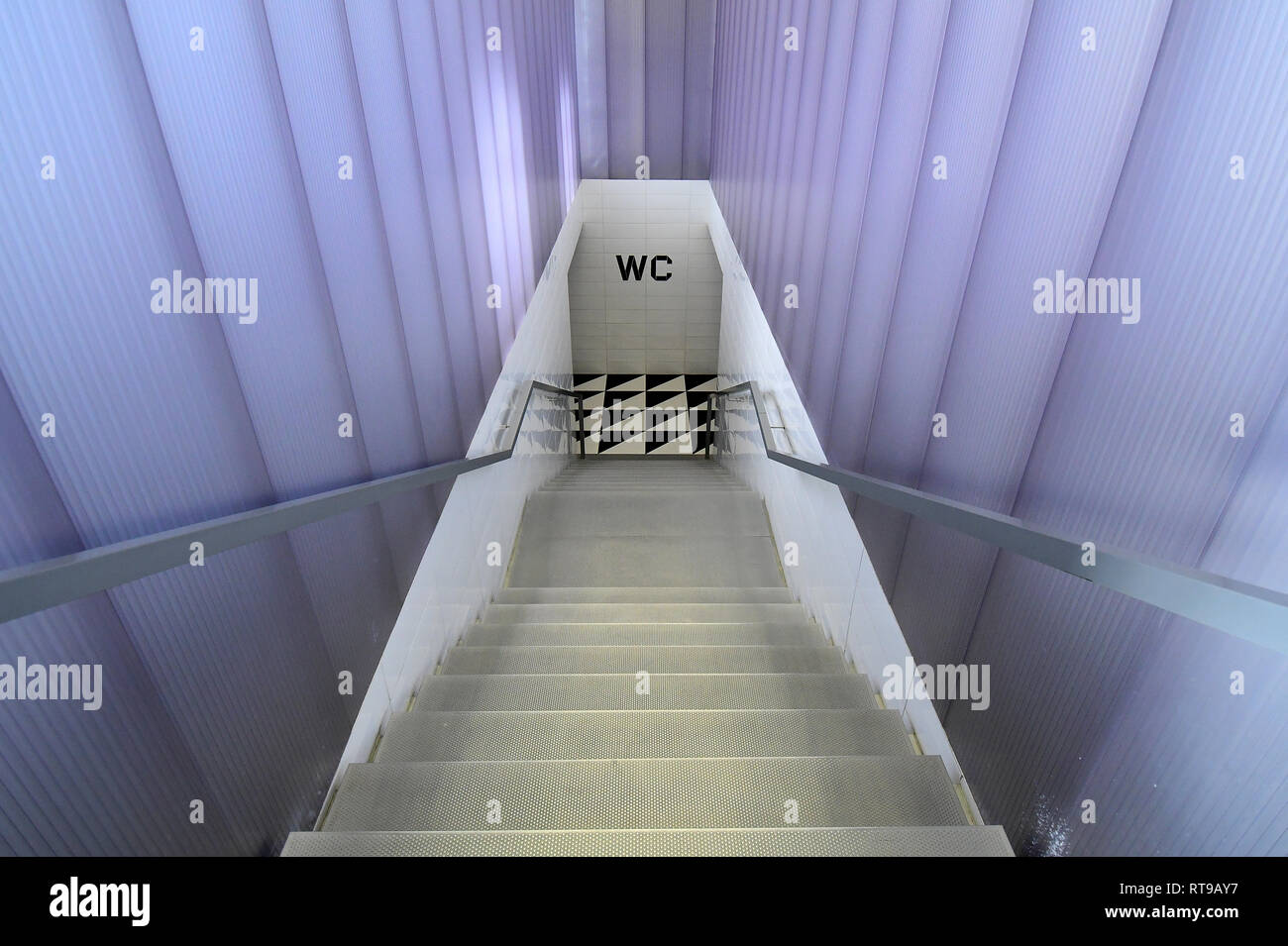 The staircase leading to the bathroom of Bar Luce, Wes Anderson-inspired bar and cafe in the Fondazione Prada district of Milan, Italy Stock Photo