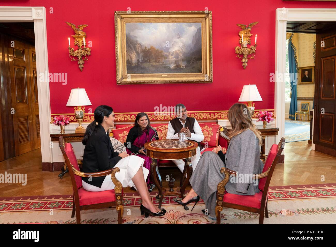 U.S. First Lady Melania Trump, right, meets with Fashion Designer Rachel Roy, left, Nobel Peace Laureate Kailash Satyarthi and his wife Sumedha Kailash in the Red Room of the White House February 25, 2019 in Washington, DC. The First Lady meets with the group to bring attention to child labor and slavery in the U.S. and abroad. - Stock Image