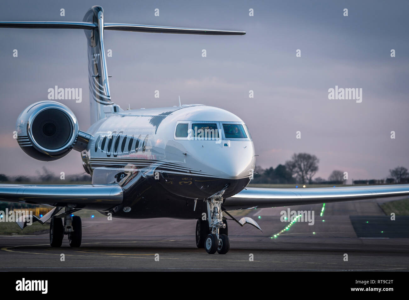 Jet aircraft starting to taxi onto the runway at Luton airport, England. - Stock Image