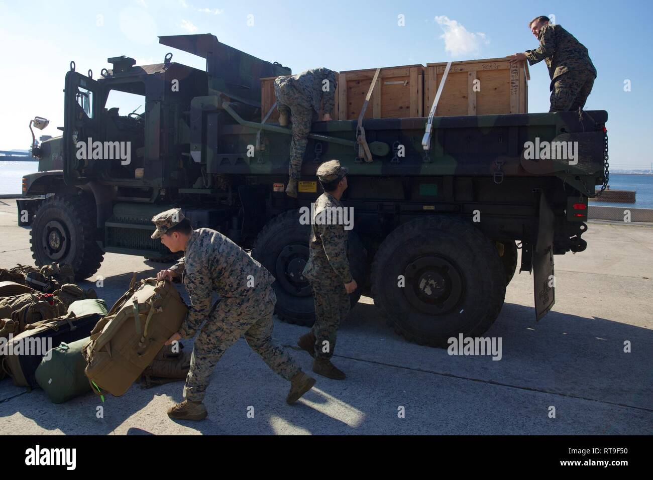 Marines with Combat Logistics Battalion 31 unload gear and
