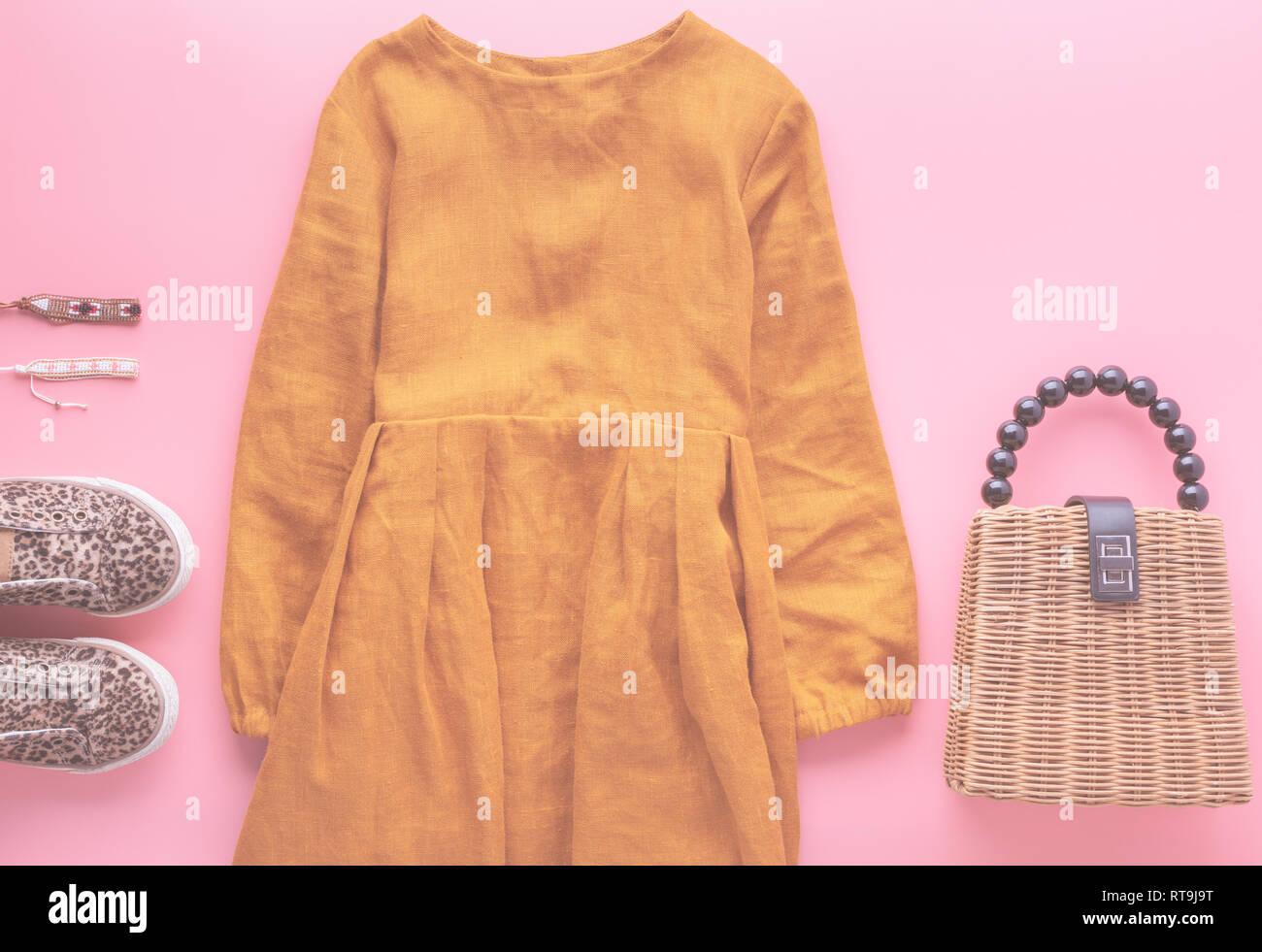 52bcf84019d4 Girls fashion background, mustard color linen dress, trendy straw bag,  leopard print shoes