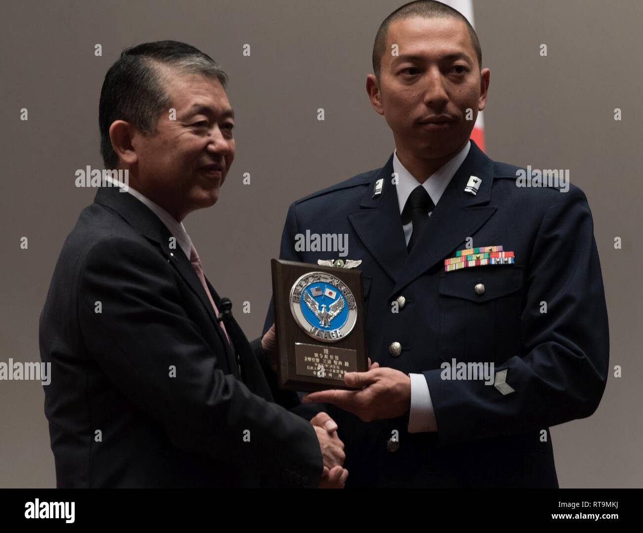 Japan Air Self-Defense Force Tech. Sgt. Tomonori Miura, 9th Air Wing Armament Maintenance Squadron munitions troop, receives an award from Mr. Shigeru Iwasaki, Japan-America Air Force Goodwill Association president, during the 2018 JAAGA Awards Ceremony January 31, 2019, at Naha Air Base, Japan. Miura was recognized for his outstanding skills as a munitions troop.  During a bilateral exchange, Miura learned about mobility maintenance at Kadena Air Base and participated in a bilateral exercise. Stock Photo