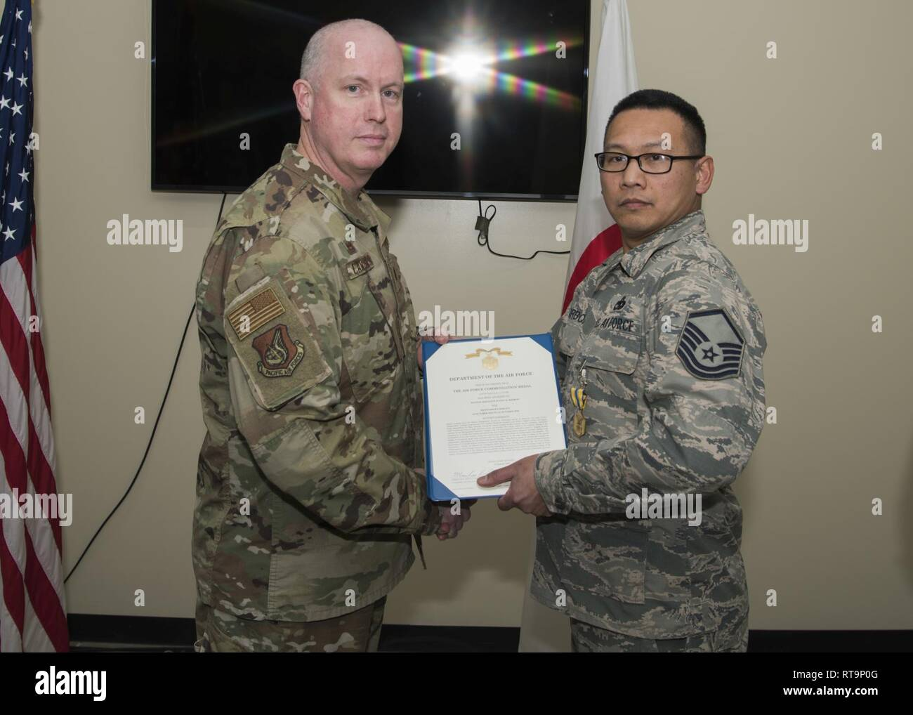 Airmen with the 35 Logistic Readiness Squadron receive a medal at Misawa Air Base, Japan, Feb. 1, 2019. Airmen that demonstration exceptional bravery and strength were pinned with a medal by the LRS commander. - Stock Image