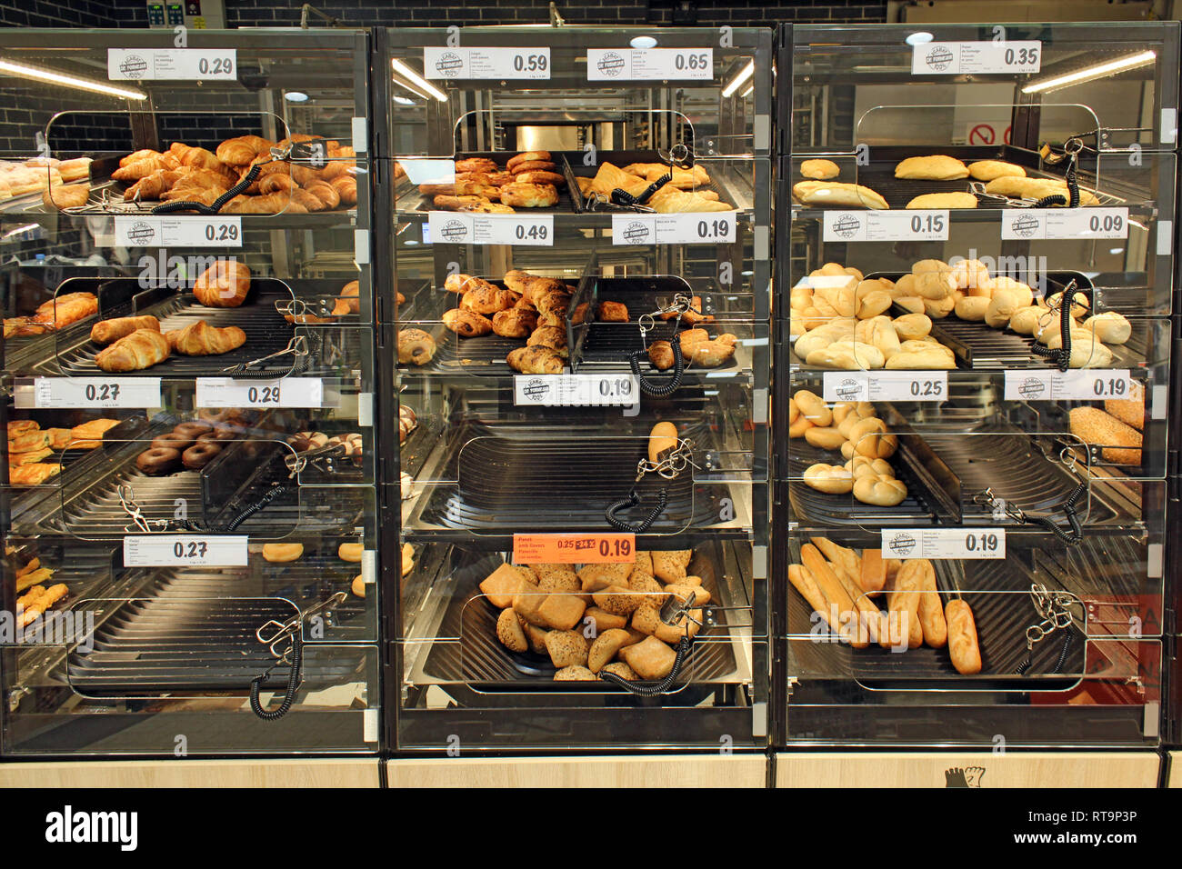 Industrial self-service bakery bread, junk food, displayed on a supermarket Stock Photo