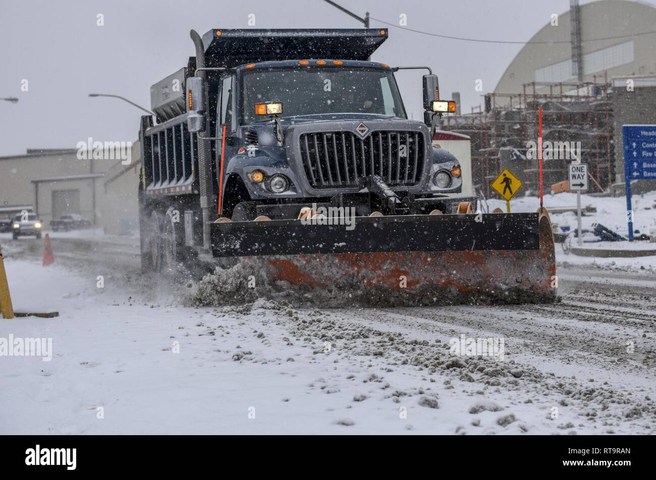 Tech. Sgt. Jason Nelson of the 171st Air Refueling Wing, Civil Engineer Squadron plows the snow to clear the roads during this mornings snowfall near Pittsburgh, Feb. 1, 2019. Nelson spent most of his morning making sure all commercial vehicles had clear, safe roads to travel on. Stock Photo
