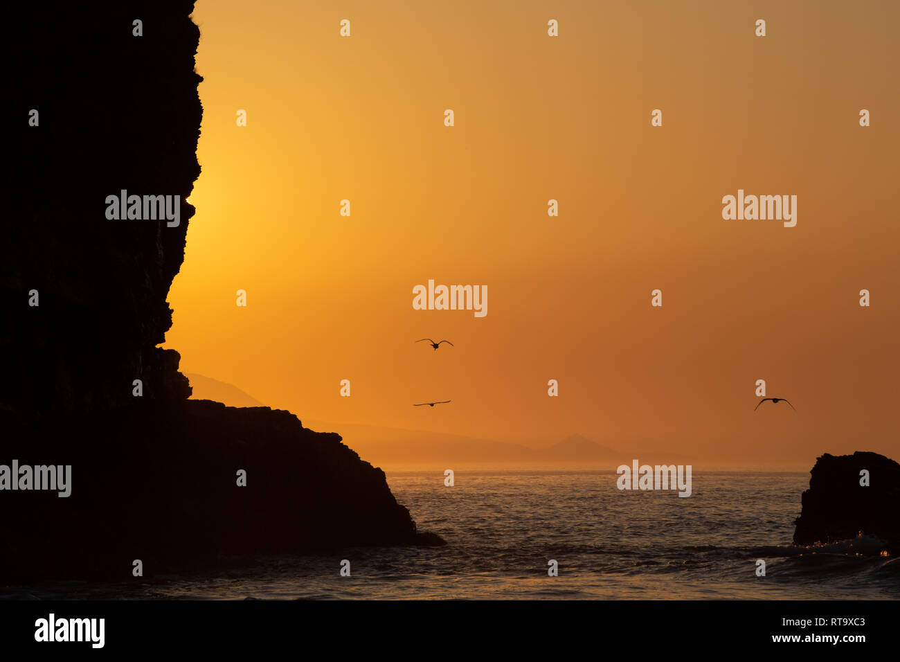 Sunset at Llangrannog, at the end of an unusually warm February, 2019. - Stock Image