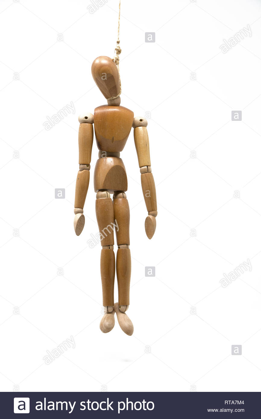 A wooden mannequin hangs from a rope around its neck. - Stock Image