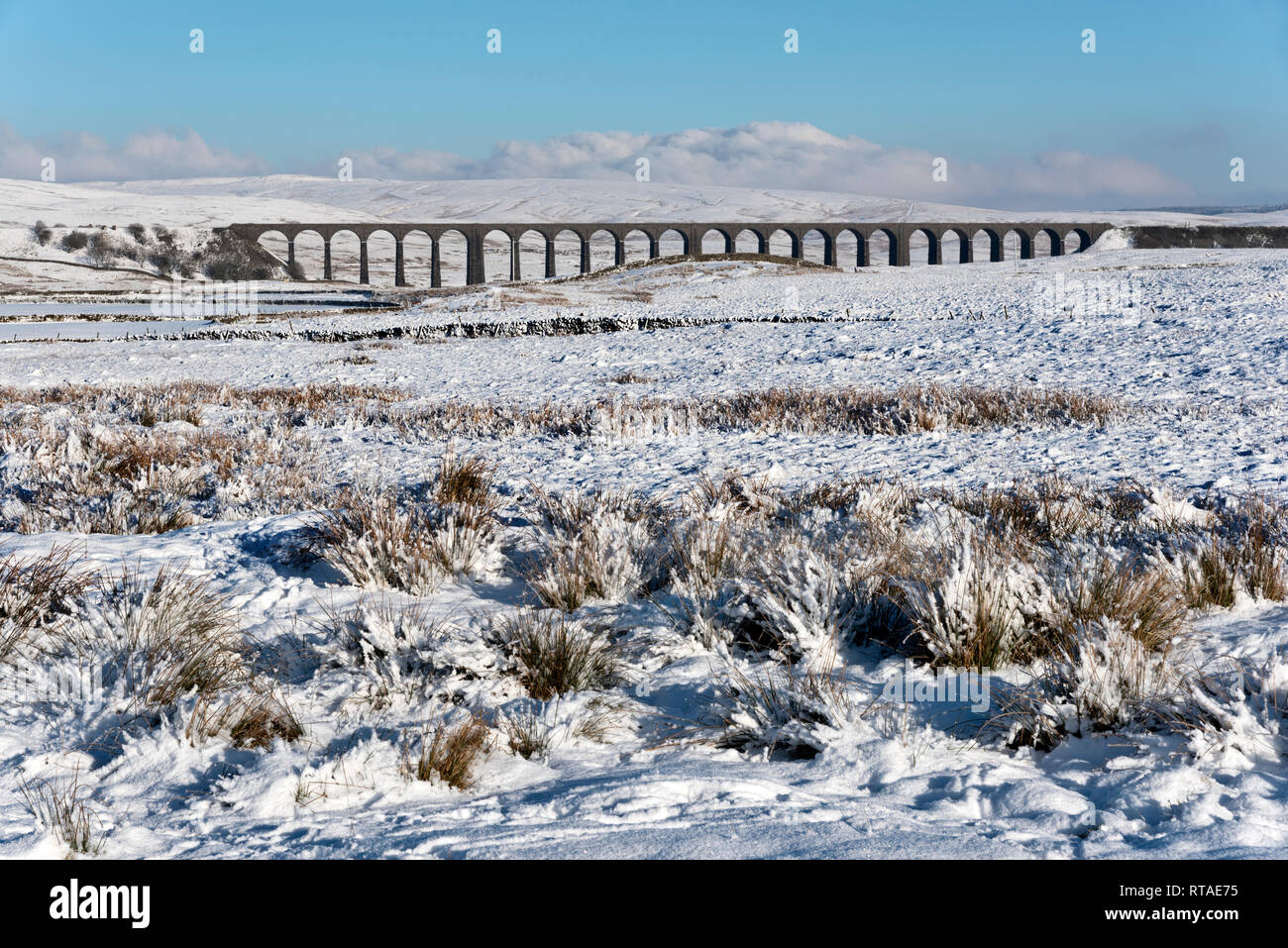 Ribblehead (Batty Moss) Viaduct in the snow, near Ingleton, Yorkshire Dales National Park, UK. Situated on the famous Settle-Carlisle railway line. - Stock Image