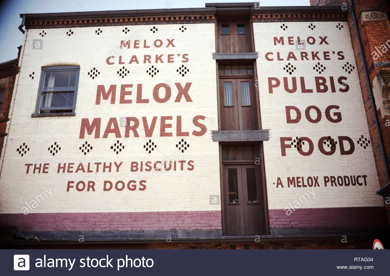 Vintage style painted wall advertisement for Melox dog biscuits. Digbeth, central Birmingham, West Midlands, UK. Stock Photo