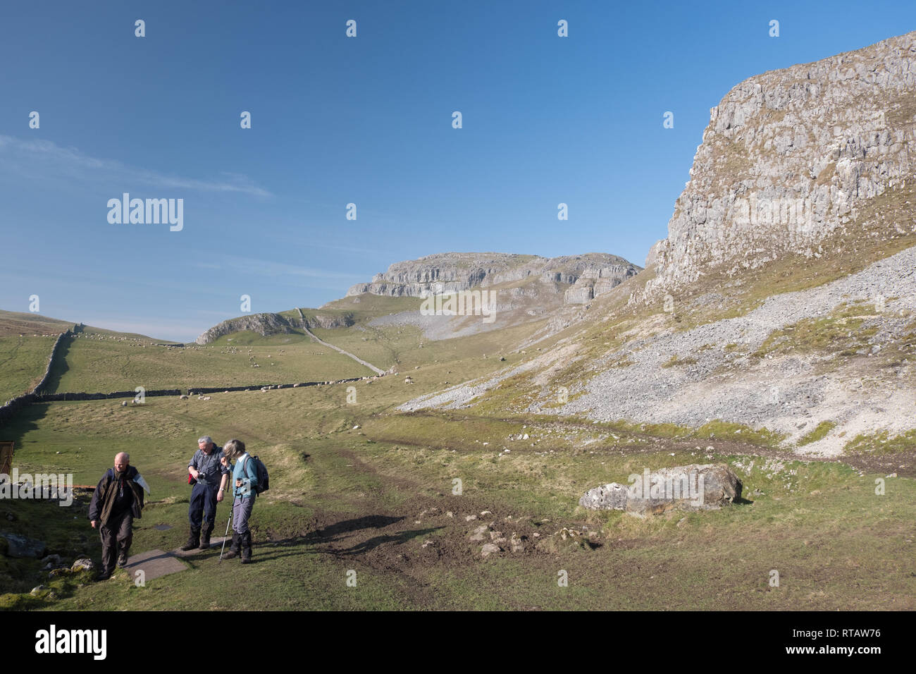 Hill walkers at Attermire above Settle in the Yorkshire Dales - Stock Image