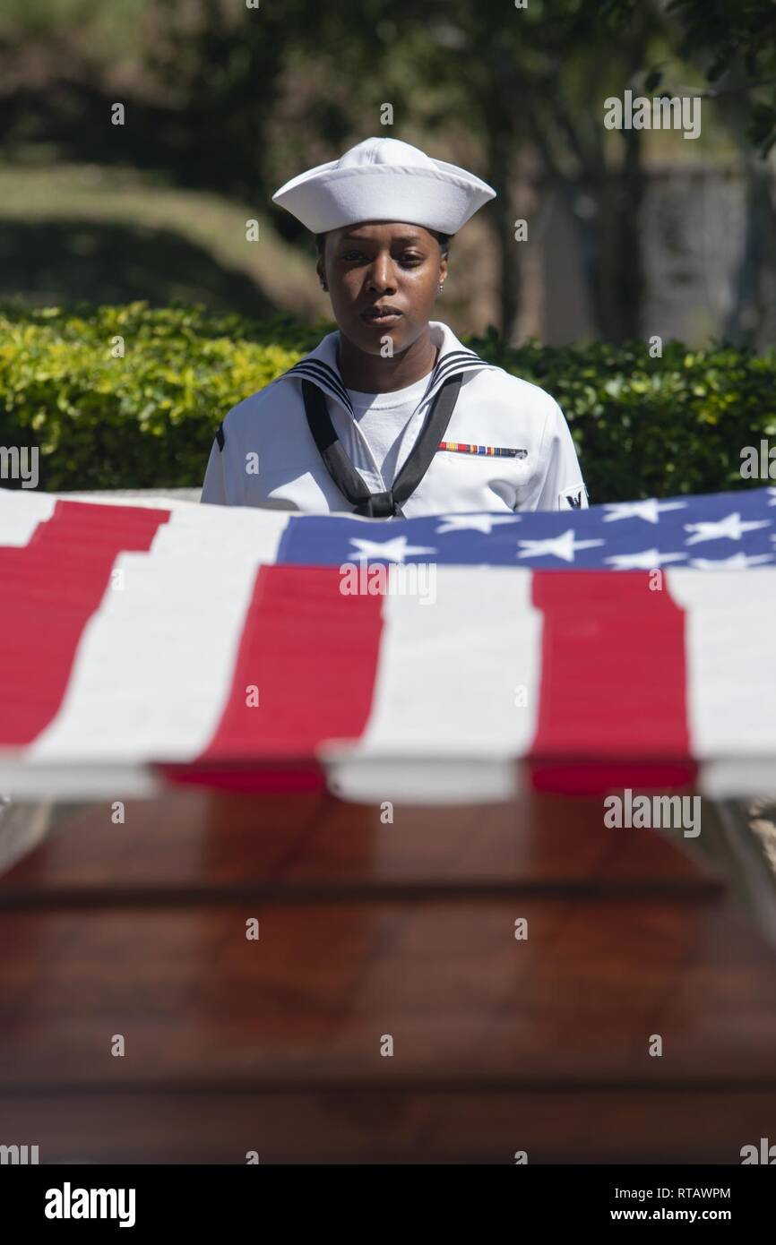 An honor guard detail, comprised of U S  Sailors assigned to