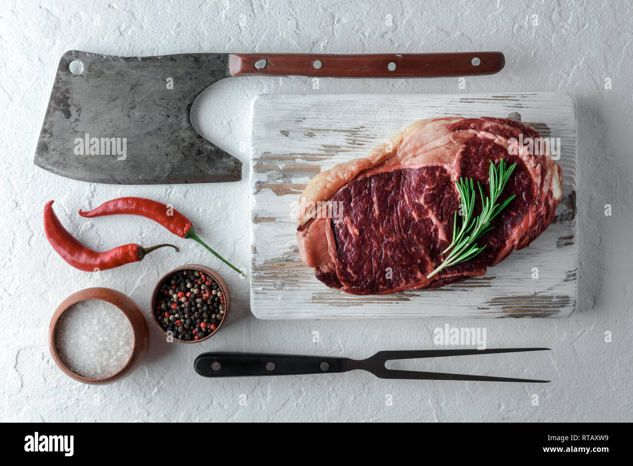 Marbling ribeye steak on black plate. Prime rib beef chop - Stock Image