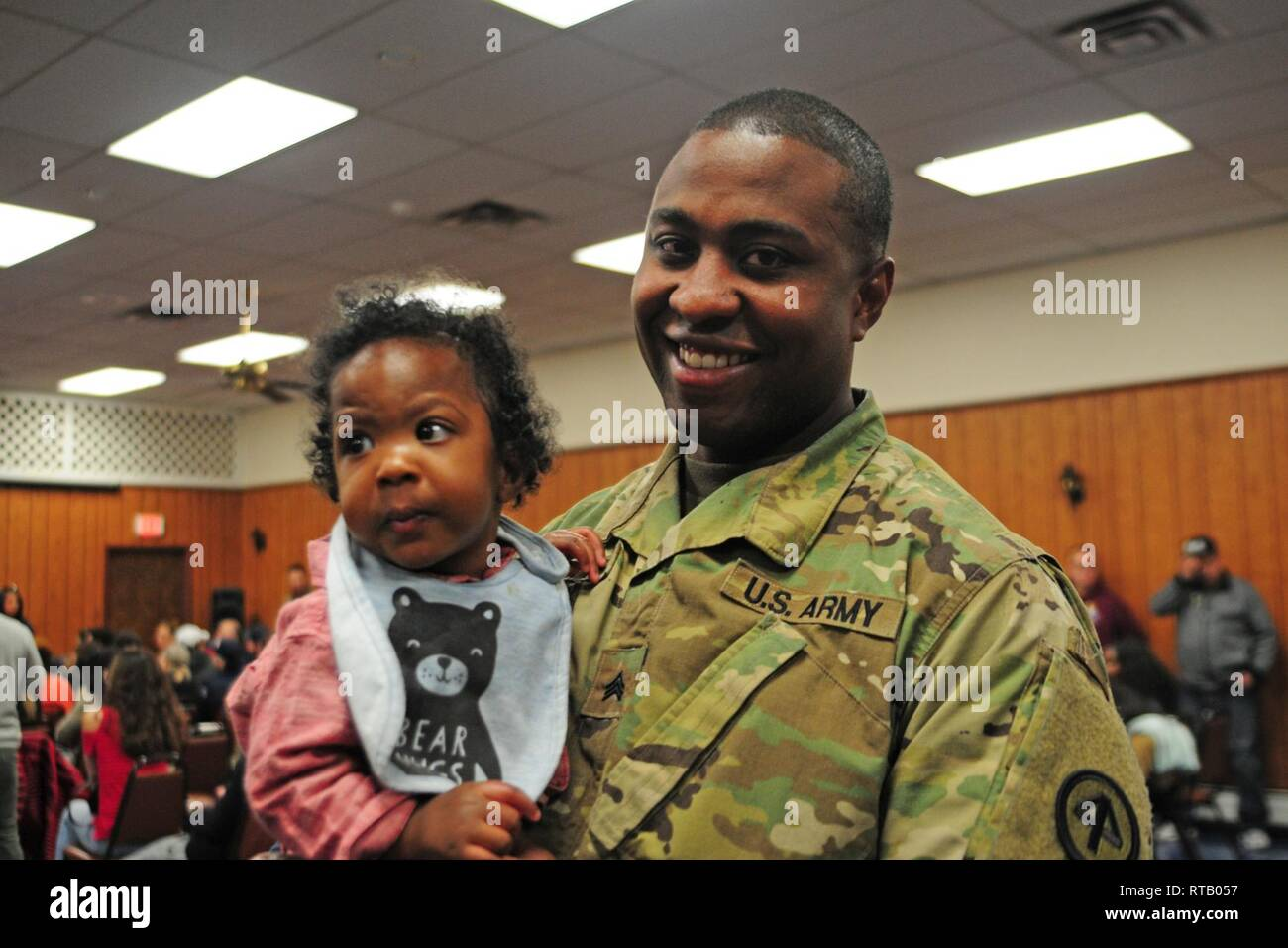 Sgt. Shavon A. Whyte poses with his son at the 250th Brigade Support Battalion's farewell ceremony. Soldiers from Hotel Company, 250th BSB, said farewell to family, friends and New Jersey National Guard leadership at a farewell ceremony Feb. 5, 2019 at the Veterans of Foreign Wars Post 5084 in Elmwood Park, New Jersey. The Teaneck-based Soldiers will deploy to the Horn of Africa in support of Operation Enduring Freedom. - Stock Image