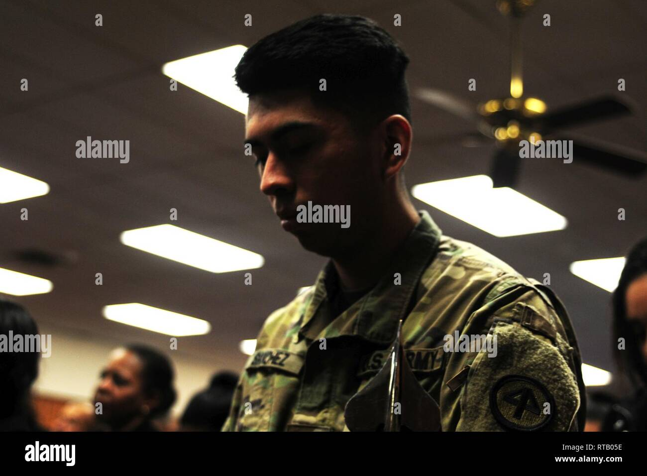 Spc. Anthony Sanchez reflects upon his upcoming deployment. Soldiers from Hotel Company, 250th Brigade Support Battalion, said farewell to family, friends and New Jersey National Guard leadership at a farewell ceremony Feb. 5, 2019 at the Veterans of Foreign Wars Post 5084 in Elmwood Park, New Jersey. The Teaneck-based Soldiers will deploy to the Horn of Africa in support of Operation Enduring Freedom. - Stock Image