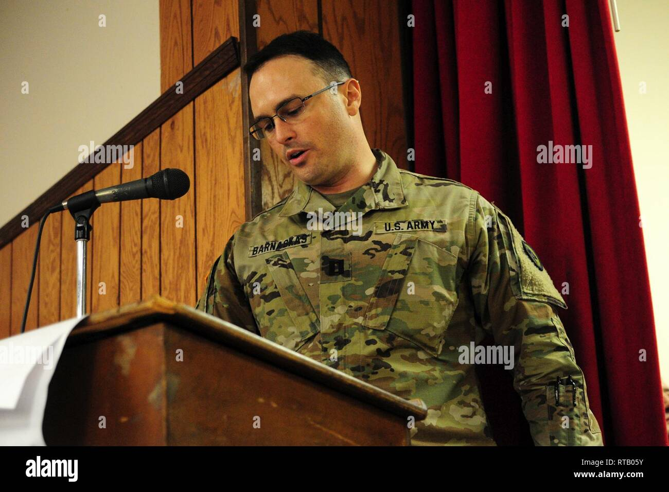 Capt. Jeremy J. Barnaskas, company commander, addresses his troops and family members at the farewell ceremony. Soldiers from Hotel Company, 250th Brigade Support Battalion, said farewell to family, friends and New Jersey National Guard leadership at a farewell ceremony Feb. 5, 2019 at the Veterans of Foreign Wars Post 5084 in Elmwood Park, New Jersey. The Teaneck-based Soldiers will deploy to the Horn of Africa in support of Operation Enduring Freedom. - Stock Image