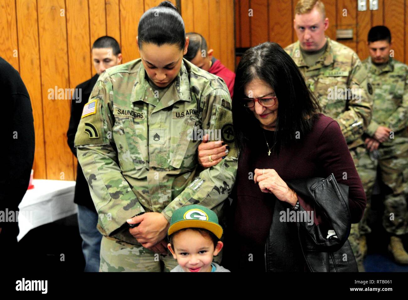 Staff Sgt. Stephanie L. Saunders bows her head during the benediction portion of the farewell ceremony. Soldiers from Hotel Company, 250th Brigade Support Battalion, said farewell to family, friends and New Jersey National Guard leadership at a farewell ceremony Feb. 5, 2019 at the Veterans of Foreign Wars Post 5084 in Elmwood Park, New Jersey. The Teaneck-based Soldiers will deploy to the Horn of Africa in support of Operation Enduring Freedom. - Stock Image