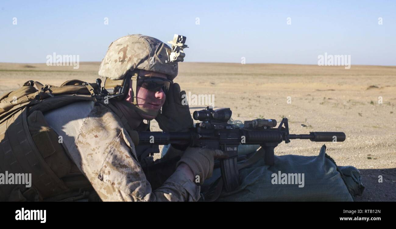 U.S. Marine Corps Cpl. Caleb Neff, a scout sniper with 3rd Battalion, 4th Marine Regiment, attached to Special Purpose Marine Air-Ground Task Force Crisis Response-Central Command, participates in a live-fire exercise during a quick-reaction-drill held in southwest Asia Feb. 5, 2019.  The SPMAGTF-CR-CC is specifically designed to be capable of deploying aviation, ground, and logistics forces forward at a moment's notice. Stock Photo