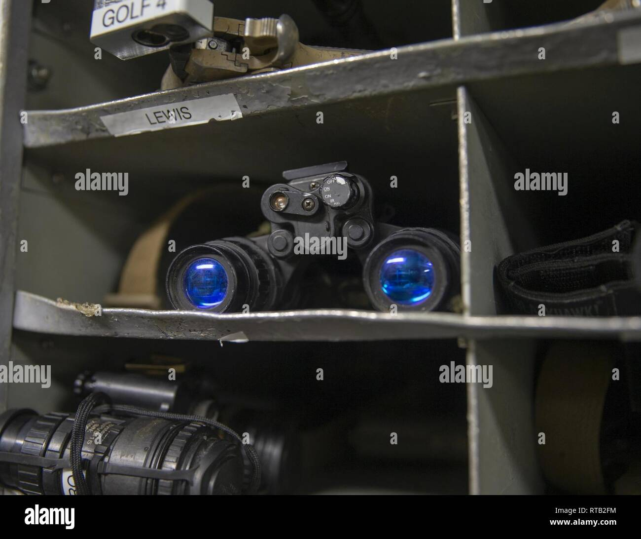 A Marine's PVS-31 night vision optics are secured in the armory of the Whidbey Island-class dock landing ship USS Fort McHenry (LSD 43), Feb. 6, 2019. The McHenry's armory stores service member's weapons and equipment. Marines and Sailors with the 22nd MEU and Kearsarge Amphibious Ready Group are currently deployed to the U.S. 5th Fleet area of operations in support of naval operations to ensure maritime stability and security in the Central Region, connecting the Mediterranean and the Pacific through the western Indian Ocean and three strategic choke points. Stock Photo