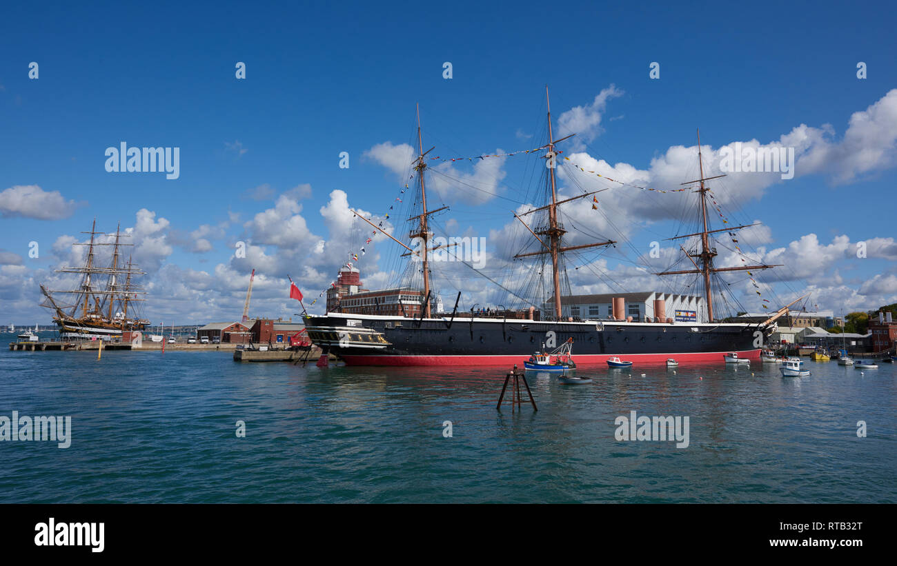 The mighty HMS Warrior ironclad warship in Portsmouth Harbour. A combination of steam-power and sailing propulsion - Stock Image
