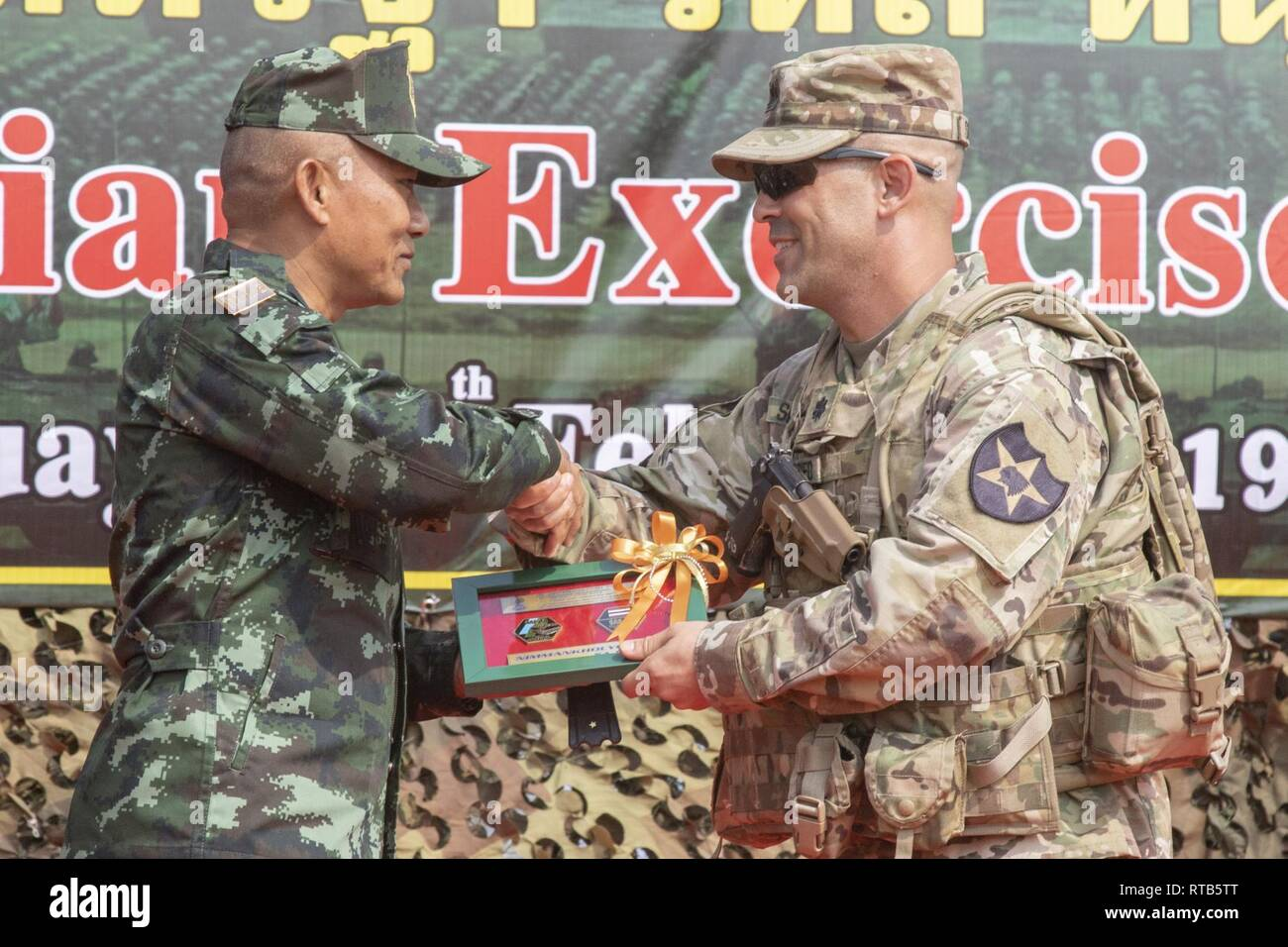 Scott Siegfried, commander of 5th Battalion, 20th Infantry Regiment, formally exchange gifts between ...