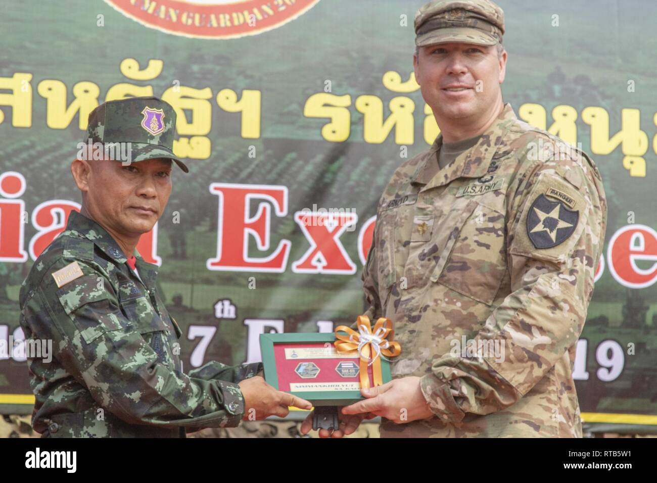 Craig Arnold, the executive officer for 5th Battalion, 20th Infantry Regiment, formally exchange gifts ...