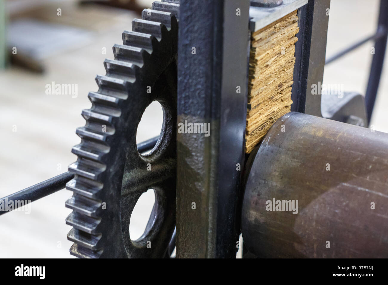gears mechanism. details of old ancient machine for making engravings - Stock Image