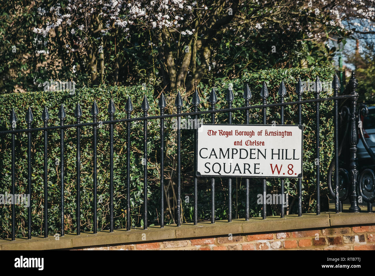 London, UK - February 23, 2019: Campden Hill Square street name sign on a black fence in The Royal Borough of Kensington and Chelsea, an affluent area Stock Photo