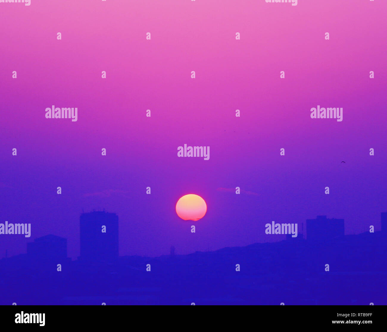 Aesthetic sunset in a purple city - Dream - Stock Image