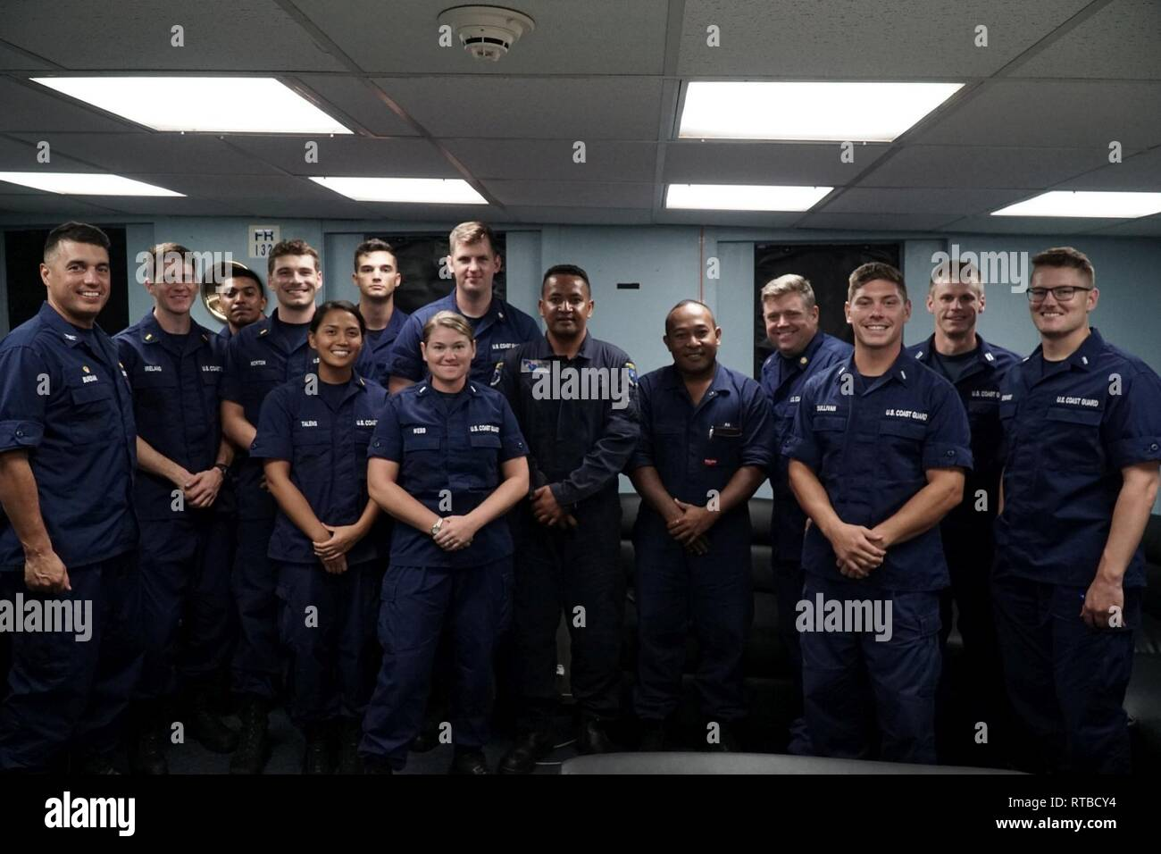 The crew of Coast Guard Cutter Mellon (WHEC 717) embarked ship riders from Tuvalu to enforce fisheries laws in each partner nations' respective exclusive economic zones (EEZ) in early 2019. The Mellon's boarding teams and the fisheries officers conducted a professional exchange and law enforcement training, sharing tactics and best practices. - Stock Image