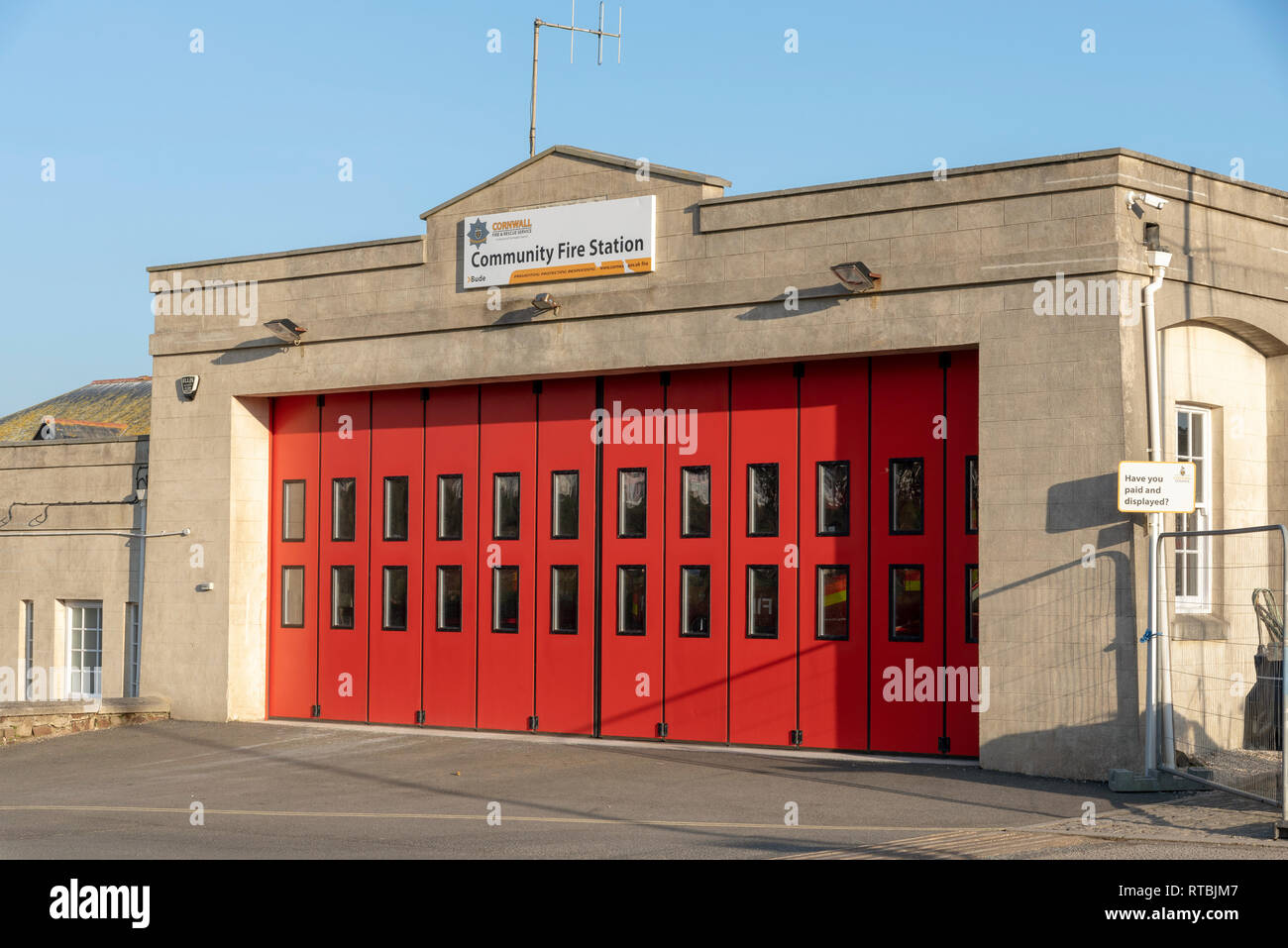 Bude, Cornwall, England UK. February 2019. The Community fire station with red sliding doors - Stock Image