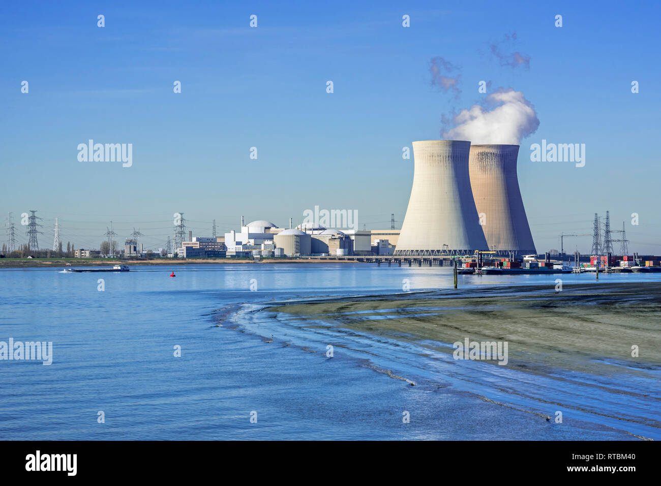 Doel Nuclear Power Station / nuclear power plant in the Antwerp harbour along the river Scheldt / Schelde, Flanders, Belgium - Stock Image