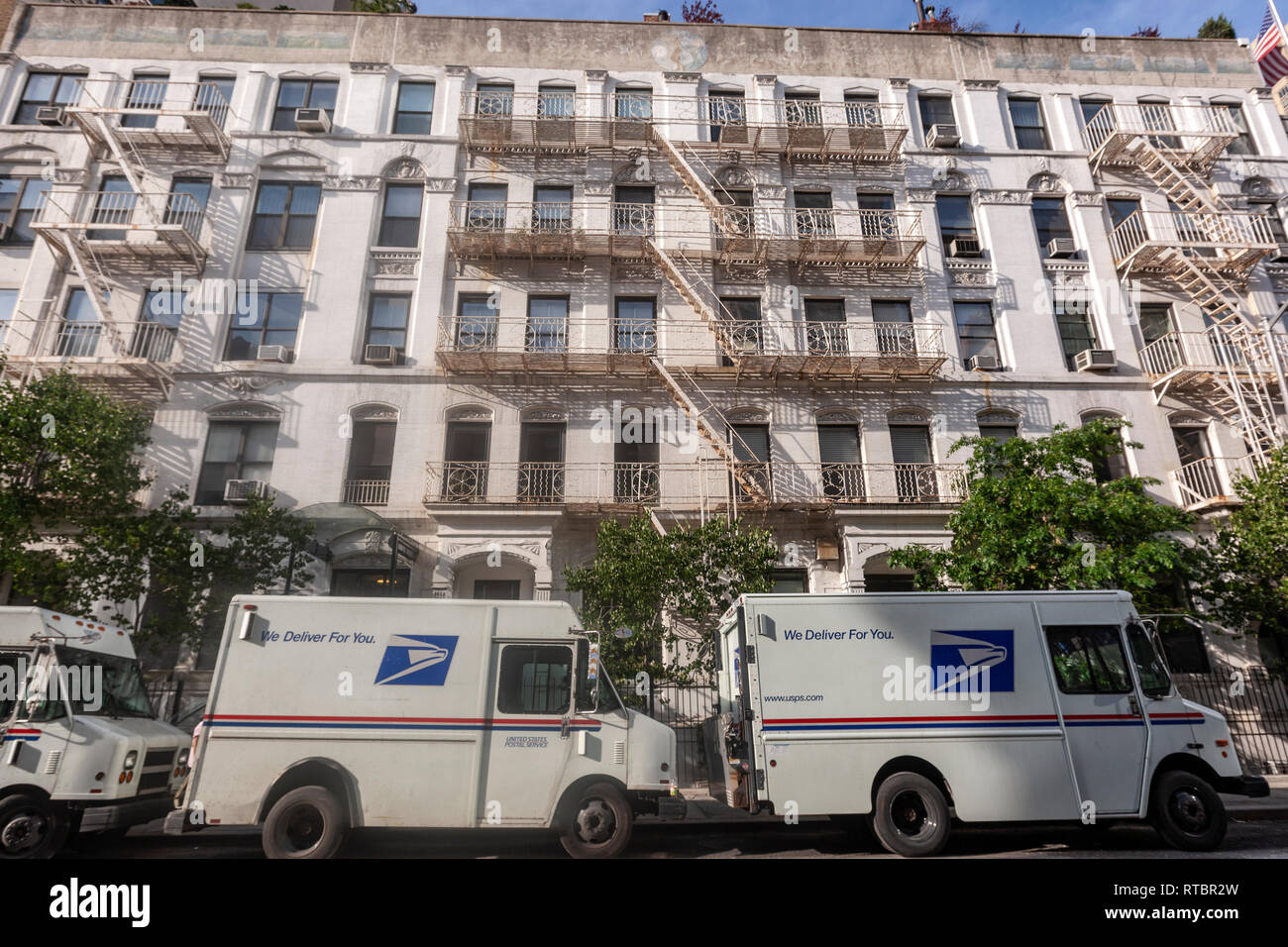 We Deliver for You UPS service vans in Manhattan, New York USA - Stock Image