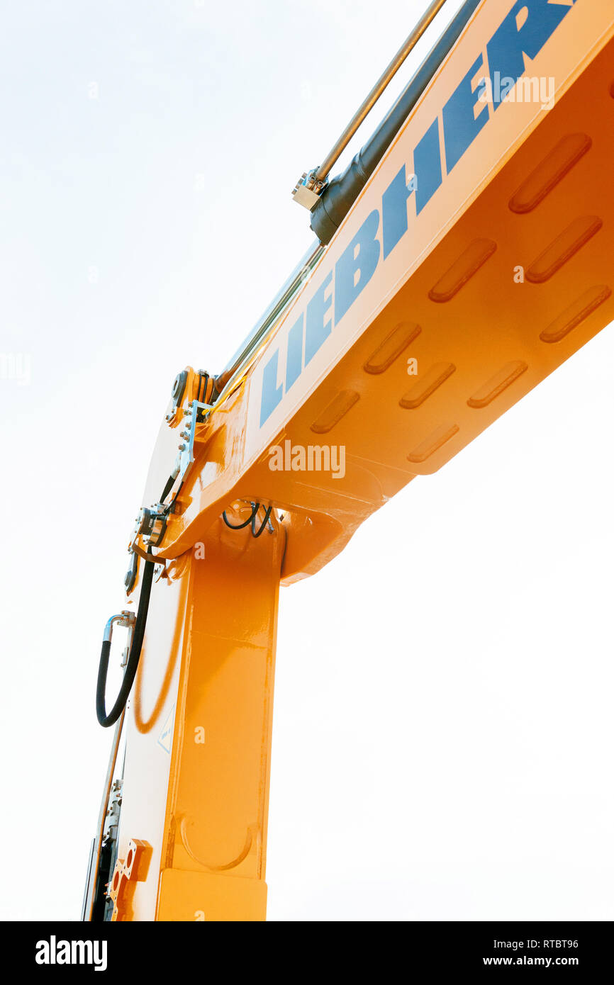 PARIS, FRANCE - SEP 3, 2014: Liebherr excavator hydraulic arm from below - protection at the construction site work security - industrial equipment as seen on construction site  - Stock Image