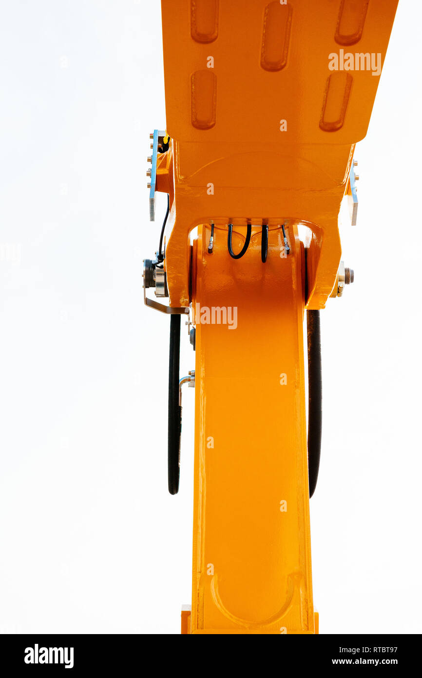 Looking at the hydraulic excavator arm from below - protection at the construction site work security - industrial equipment as seen on construction site  - Stock Image