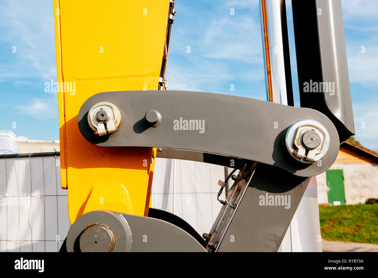 Hydraulic excavator arm - industrial equipment as seen on construction site  - Stock Image