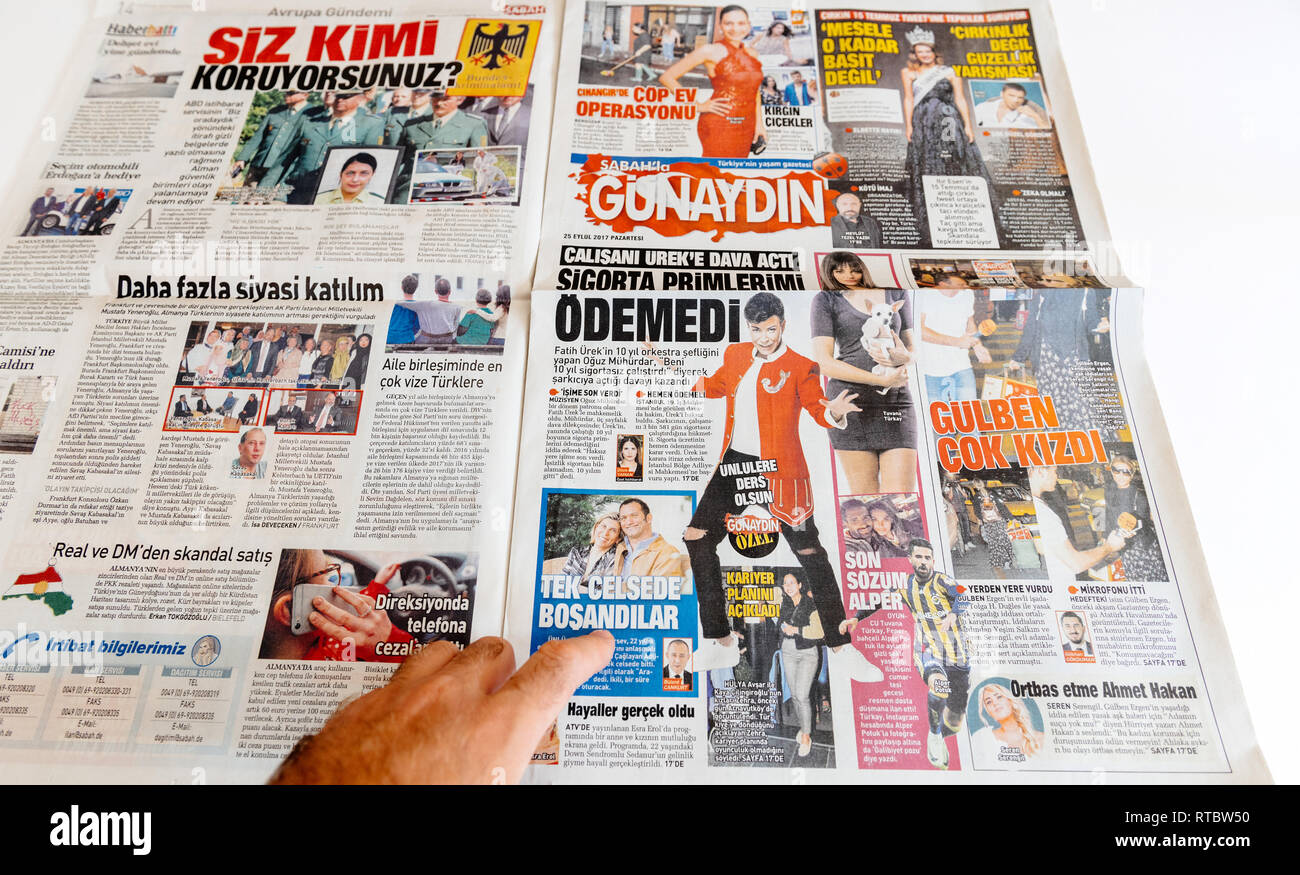 PARIS, FRANCE - SEP 25, 2017: Man reading Sabah Turkish newspaper about entertainment and lifestyle news - Stock Image