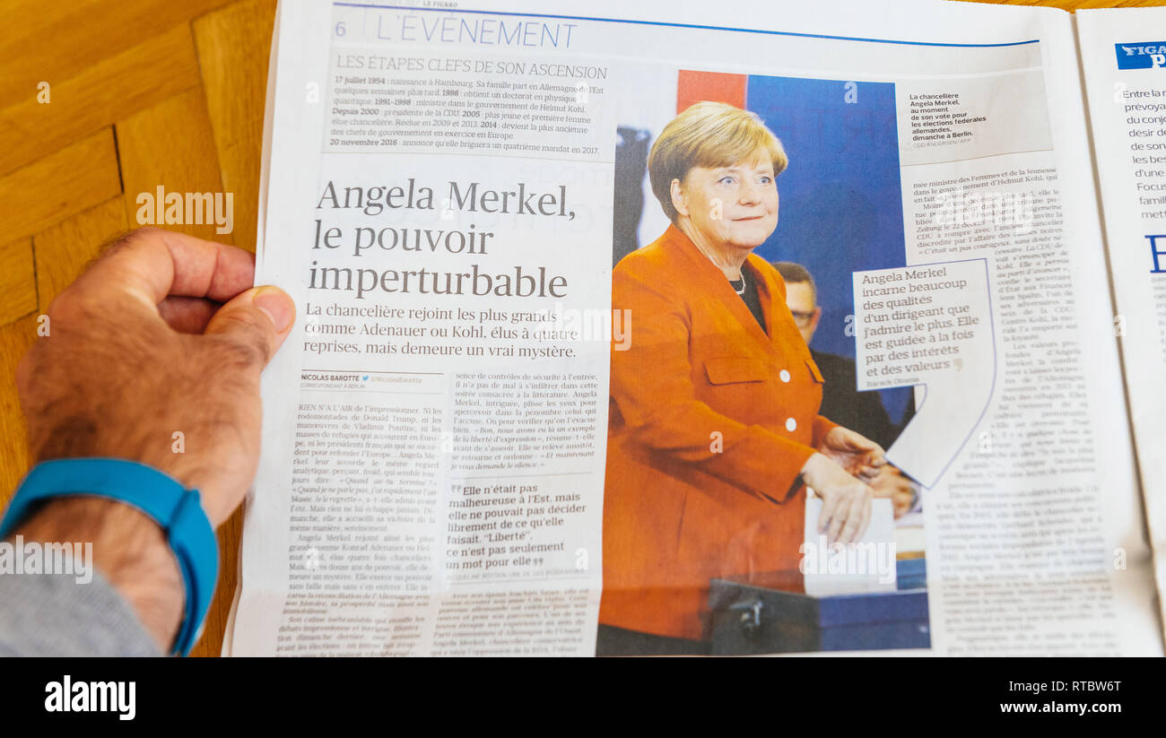 PARIS, FRANCE - SEP 25, 2017: Le Figaro French International newspaper with portrait of Angela Merkel after election in Germany for the Chancellor of Germany, the head of the federal government - Stock Image