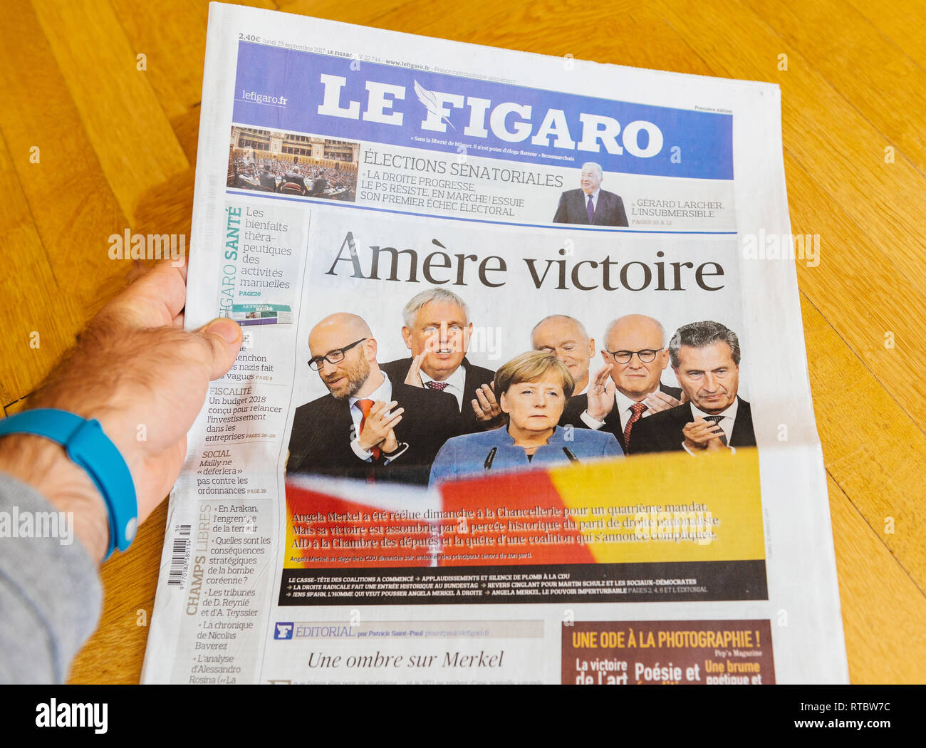 PARIS, FRANCE - SEP 25, 2017: Sad winning Le figaro International newspaper with portrait of Angela Merkel after election in Germany for the Chancellor of Germany, the head of the federal government - Stock Image