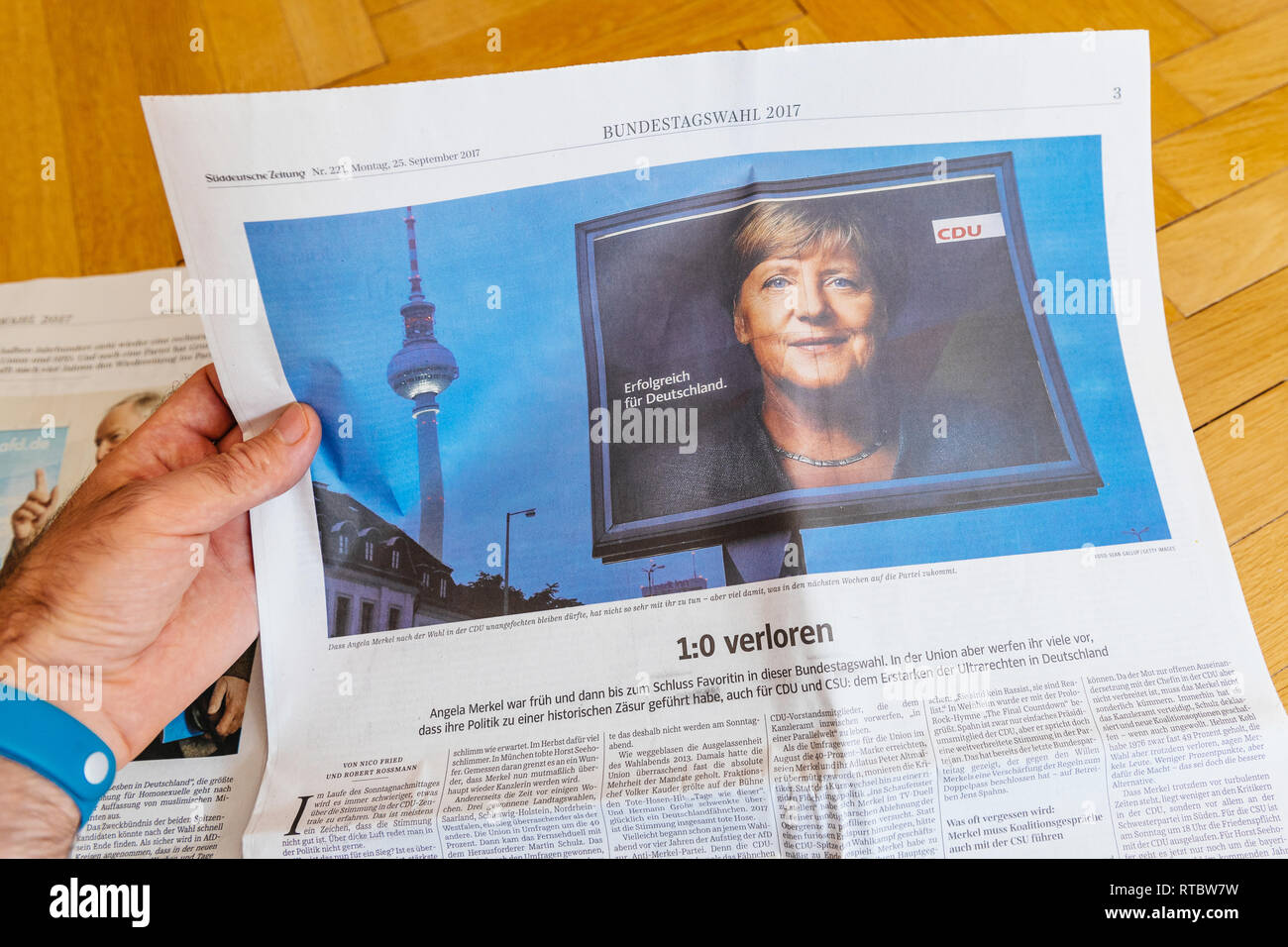 PARIS, FRANCE - SEP 25, 2017: suddeutsche zeitung newspaper with portrait of Angela Merkel after election in Germany for the Chancellor of Germany, the head of the federal government - Stock Image