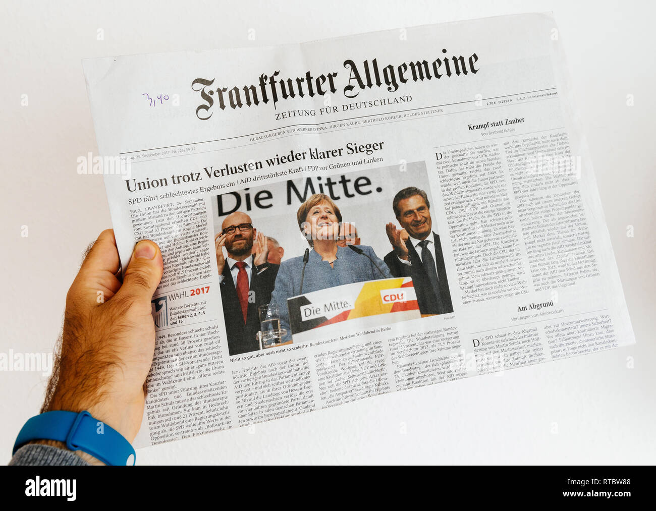 PARIS, FRANCE - SEP 25, 2017: International newspaper with portrait of Angela Merkel after election in Germany for the Chancellor of Germany, the head of the federal government - Stock Image