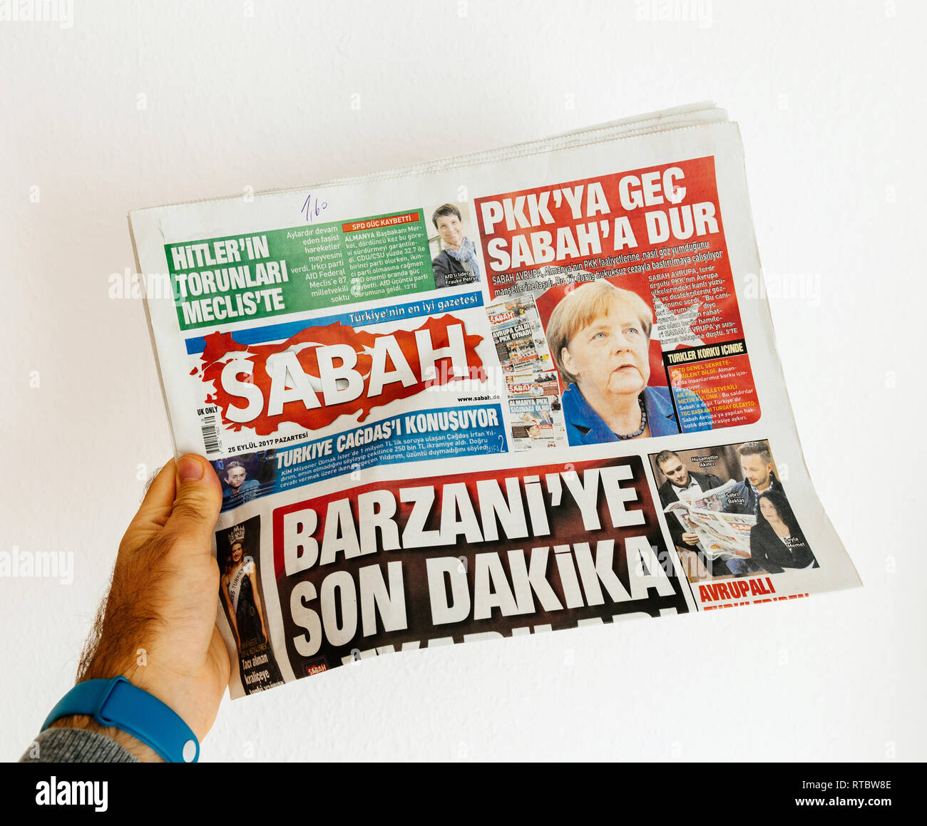 PARIS, FRANCE - SEP 25, 2017: Sabah  Turkish daily newspaper with portrait of Angela Merkel after election in Germany for the Chancellor of Germany, the head of the federal government - Stock Image
